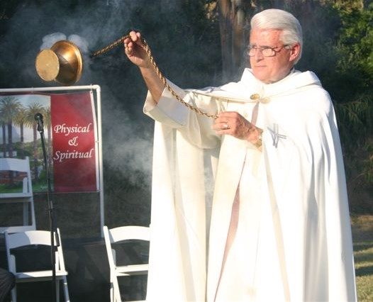 Father Manny blessing at the groundbreaking
